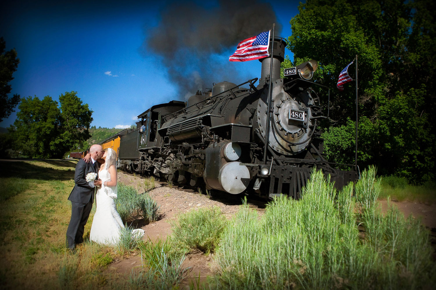 Bride & Groom in front of the Durango Silverton train