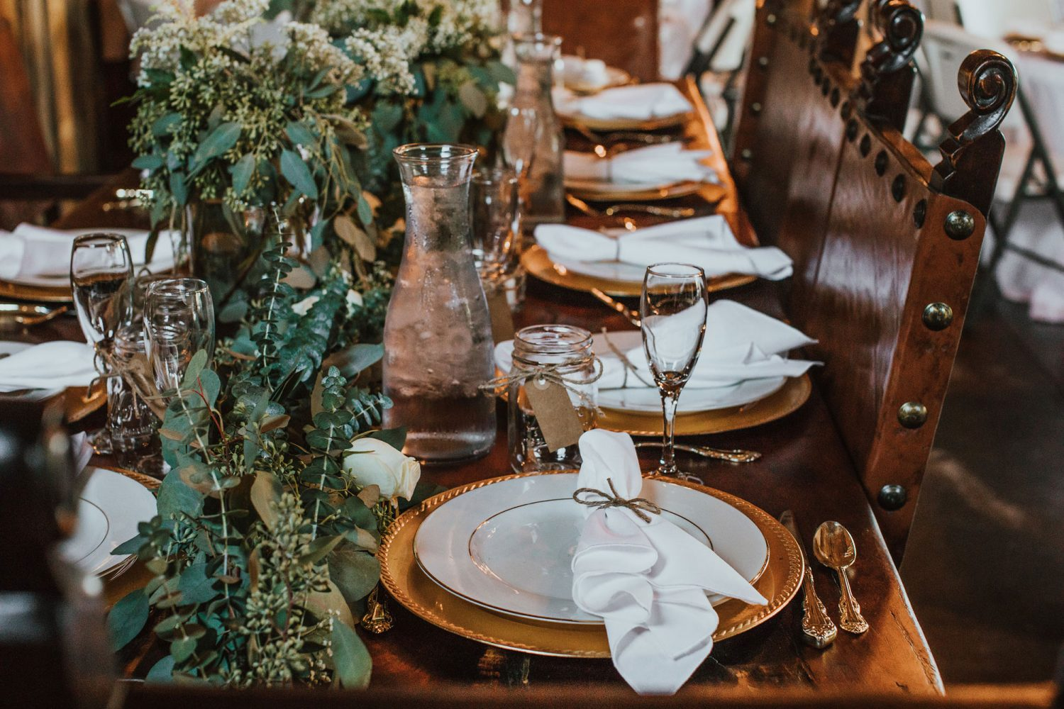Rustic glam tablescape from a barn reception at Triple J Ranch in Kirtland, New Mexico