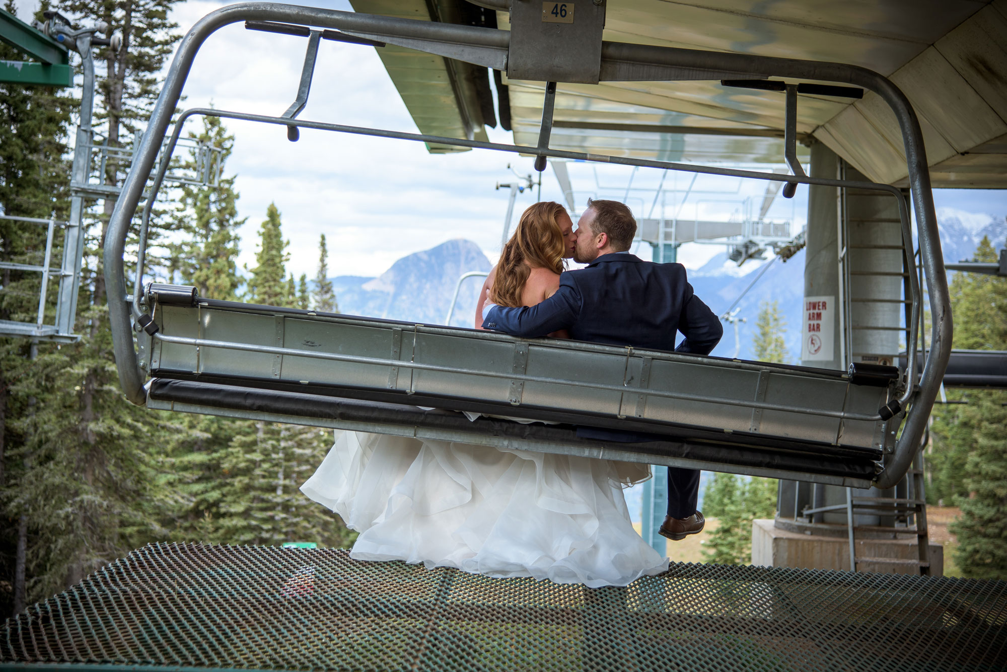 Birde and groom riding the chairift at Purgatory Resort, Durango, Colorado