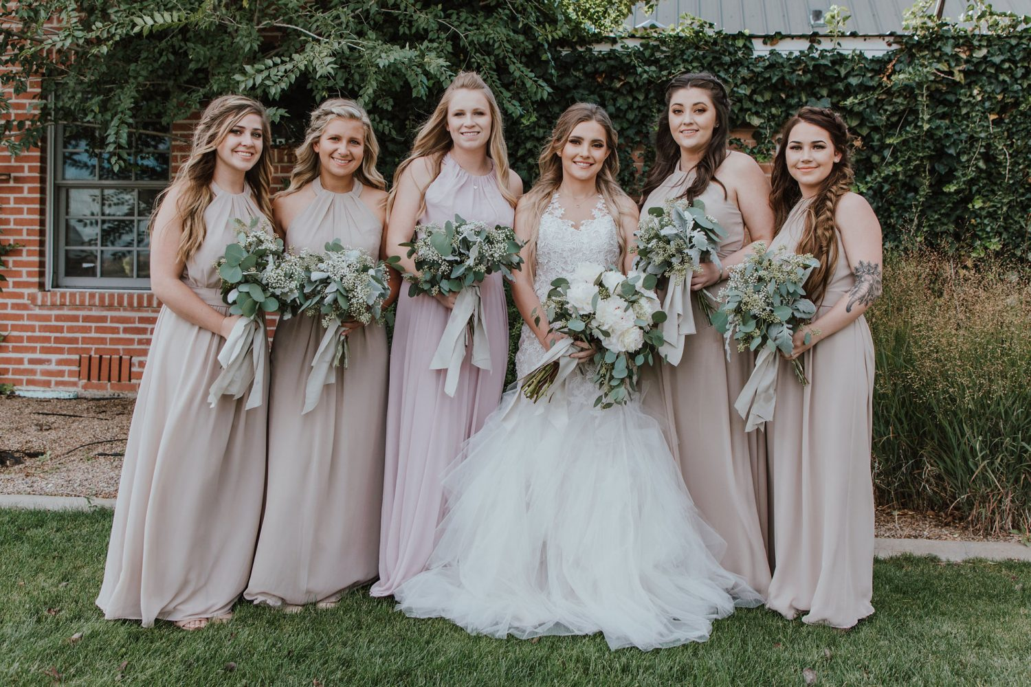 Bridesmaids from a Rustic Glam Wedding at Triple J Ranch in Kirtland, New Mexico