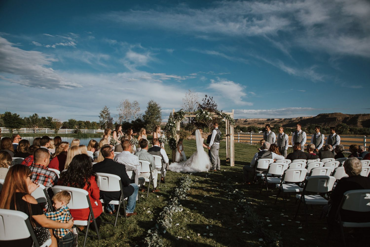 Outdoor ceremony from a Rustic Glam Wedding at Triple J Ranch in Kirtland, New Mexico
