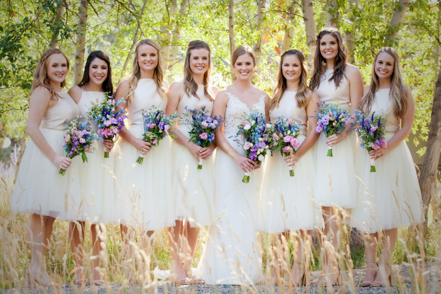 Bridesmaids wearing ivory from a Backyard wedding in Durango, Colorado