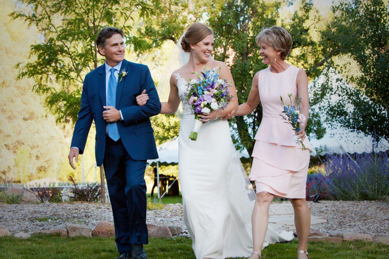 Mom & Dad walking bride down the aisle in an outdoor ceremony in Durango, Colorado