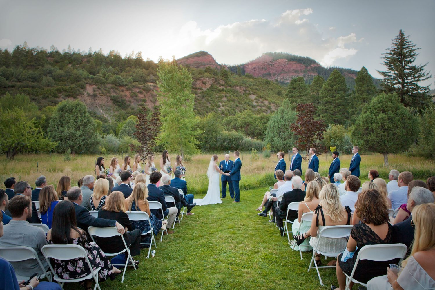 An outdoor backyard ceremony with the animas cliffs in Durango, Colorado