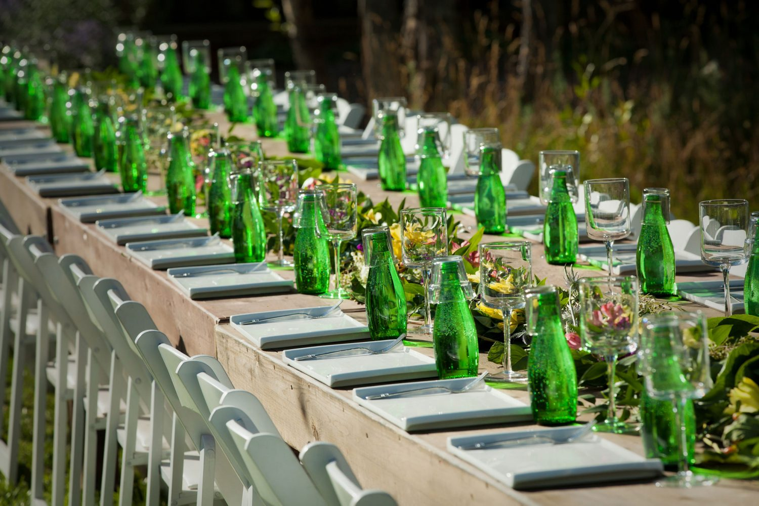 Long farm tables from a backyard reception on the lawn in the Animas Valley of Durango, Colorado