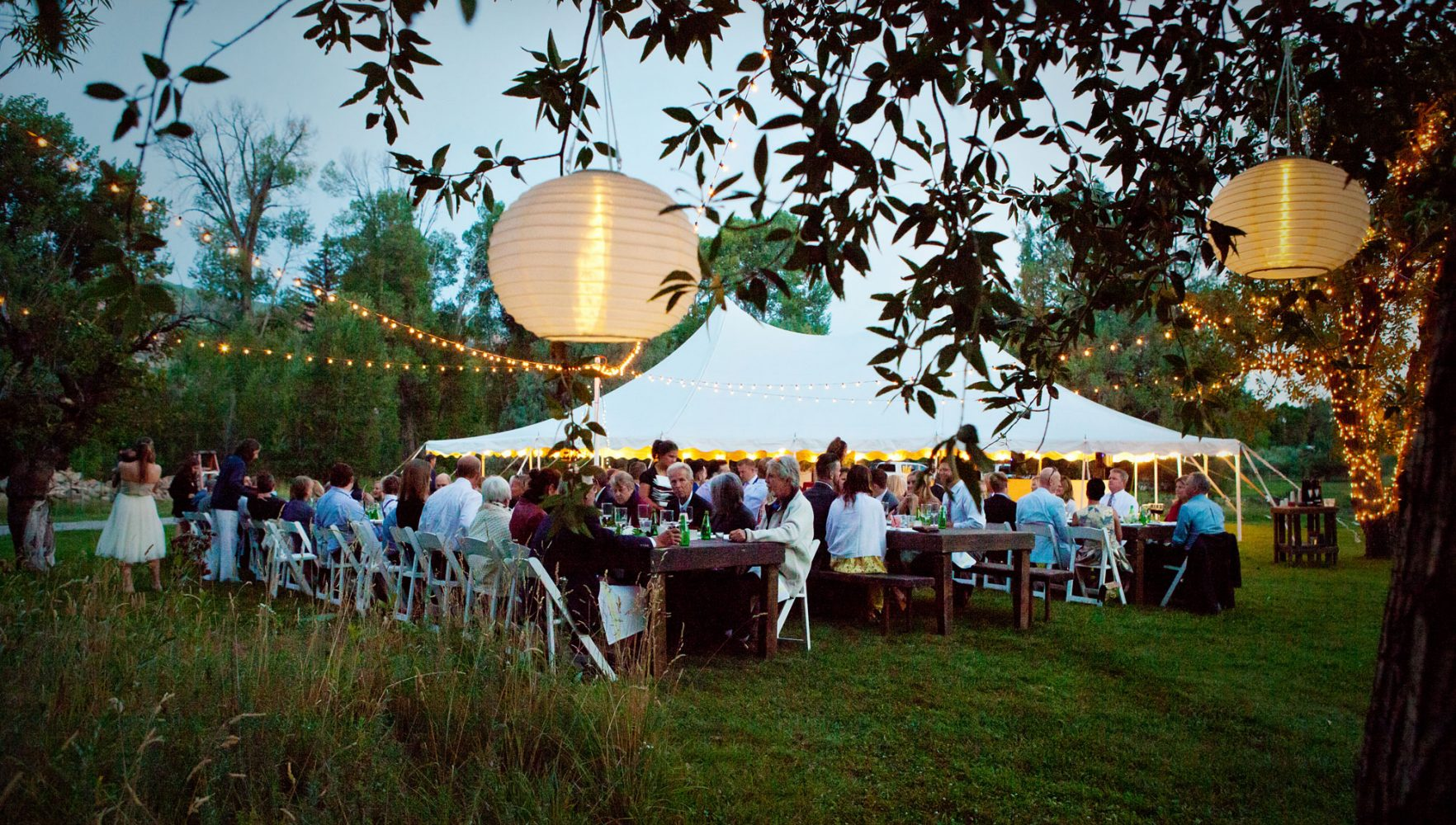 A tent reception fom a backyard wedding on the lawn in the Animas Valley of Durango, Colorado