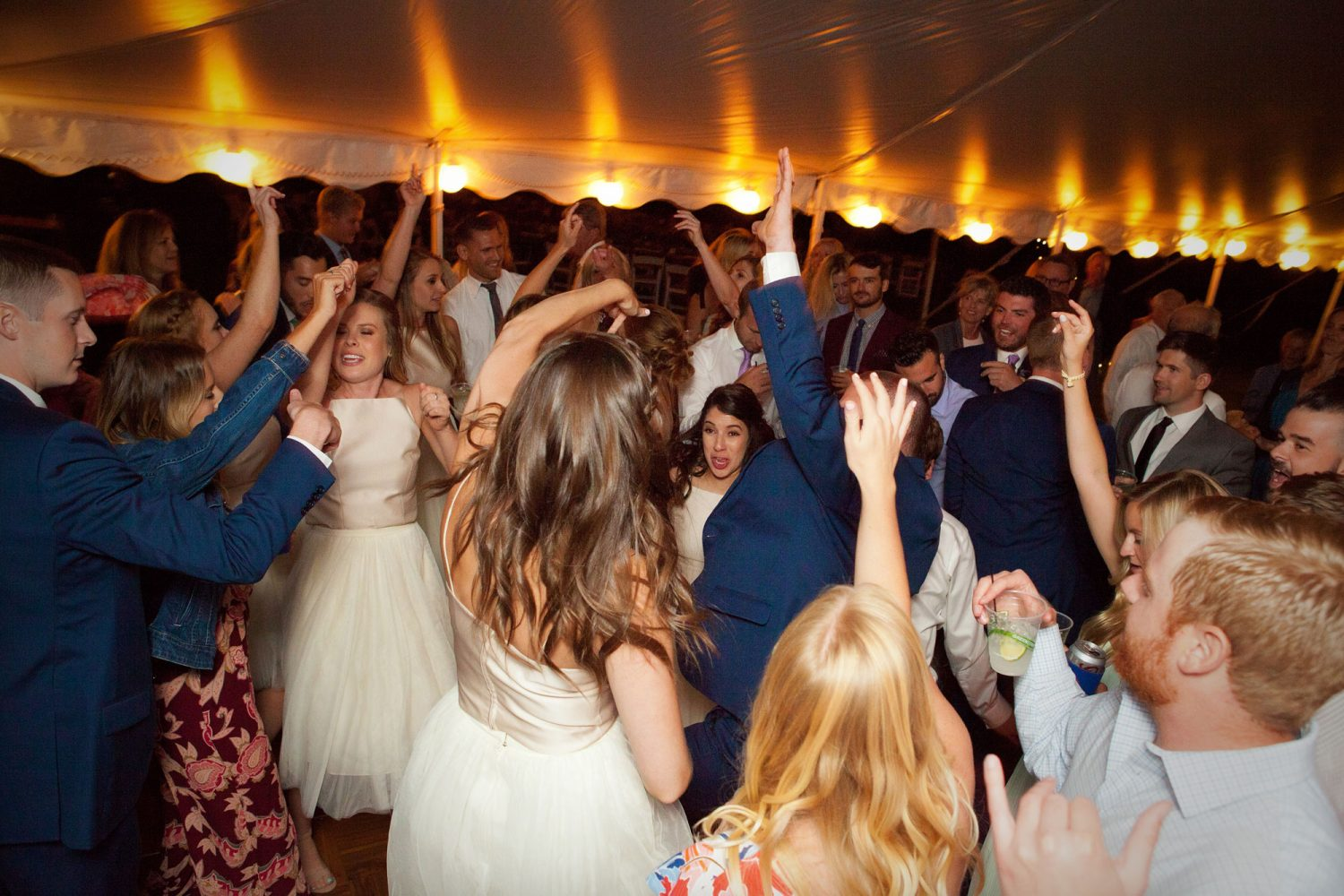 Dancing under the tent at a wedding in the Animas Valley of Durango, Colorado