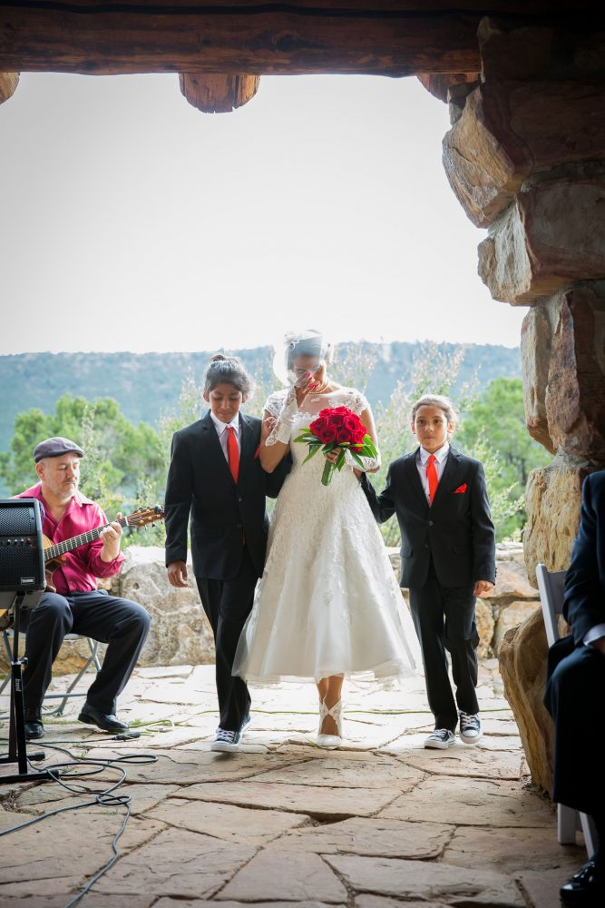 Bride and sons walking down the asle in Durango, Colorado