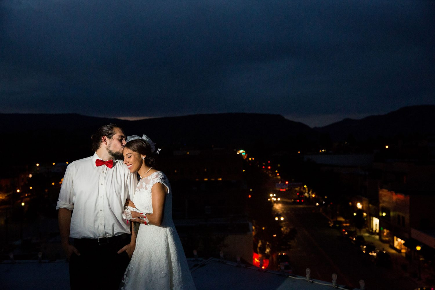 Bride and groom on the rooftop of the Strater Hotel overlooking downtown Durango, Colorado