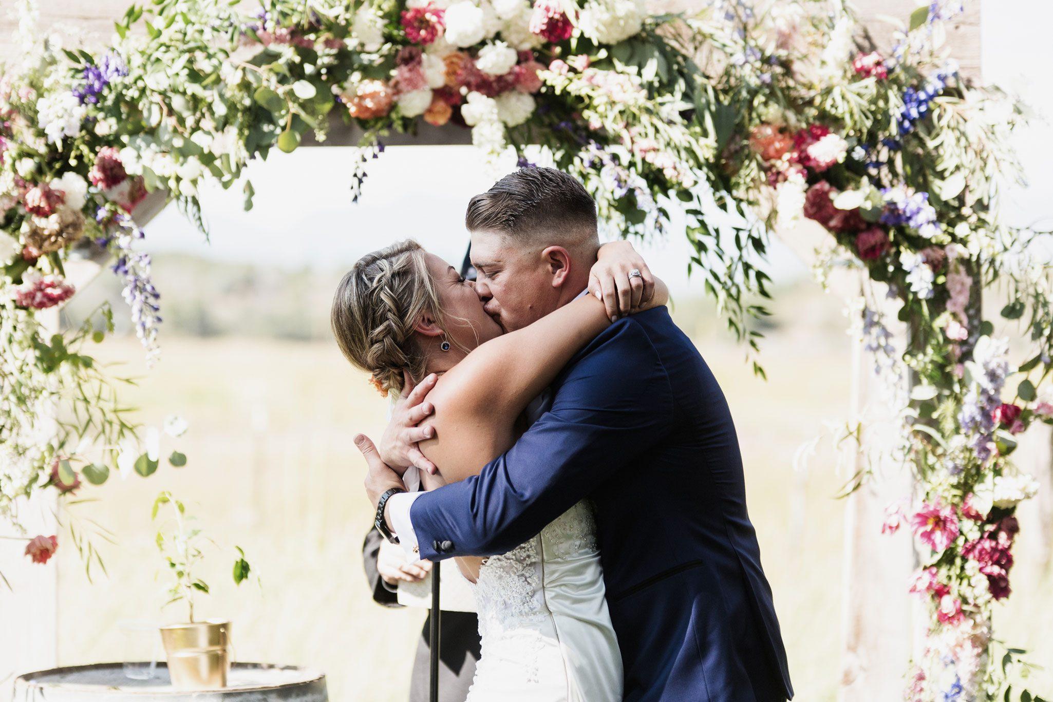 "The kiss after saying ""I do"" at Ridgewood Event Center, Durango, Colorado"