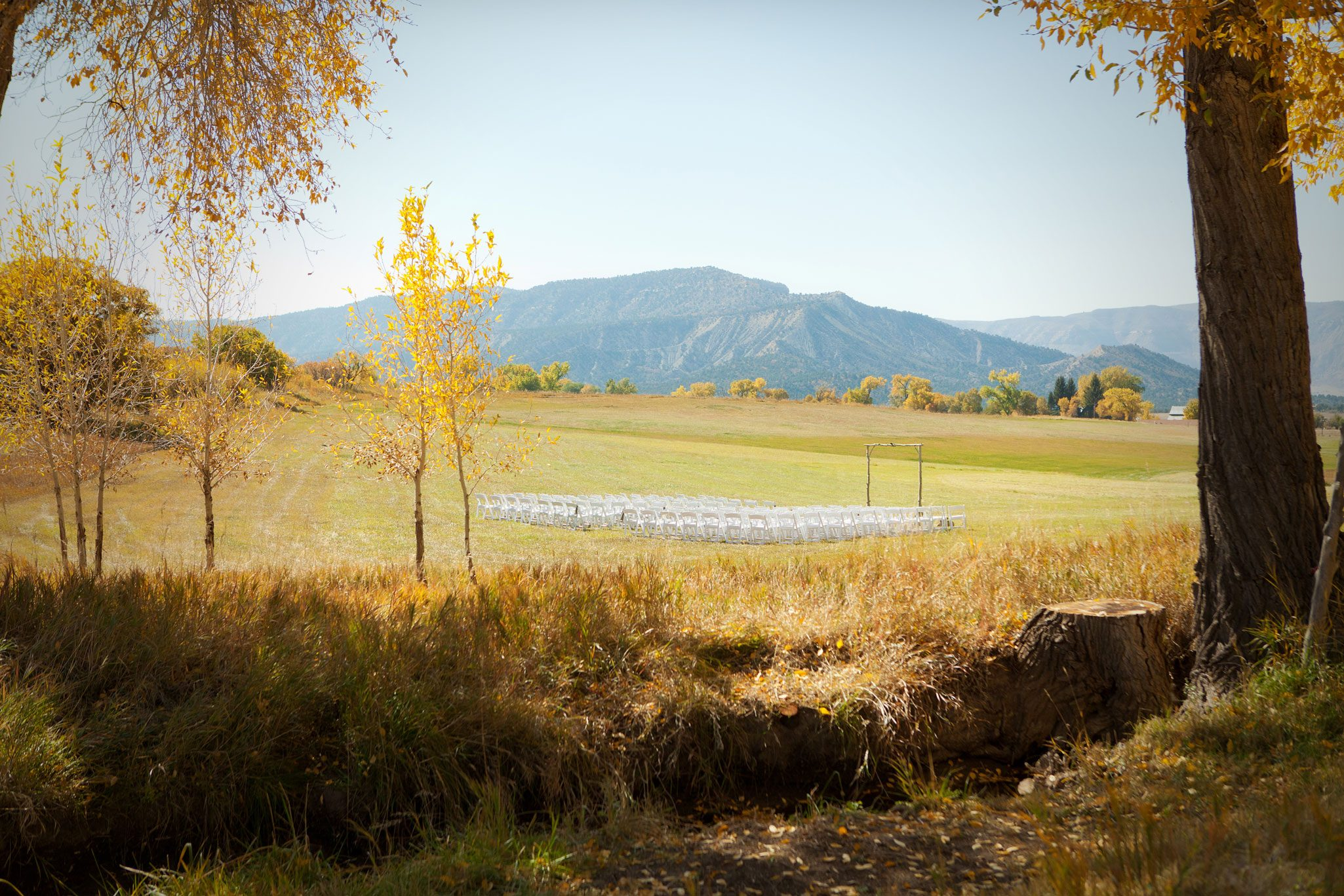 Fall wedding ceremony in a field in Mancos, Colorado