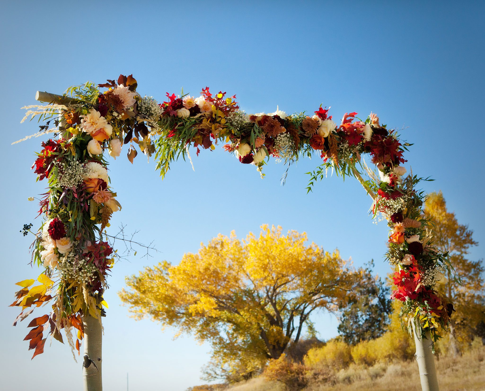 Floral covered ceremony arch