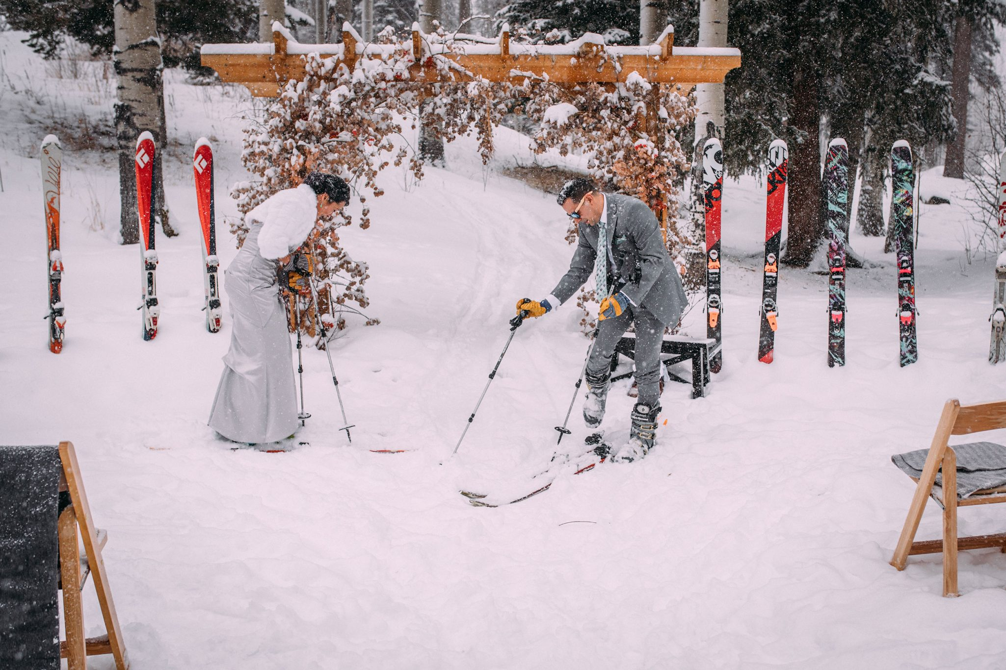Ceremony in skis | A Winter Wedding in the Snow at Silverpick Lodge, Durango Colorado