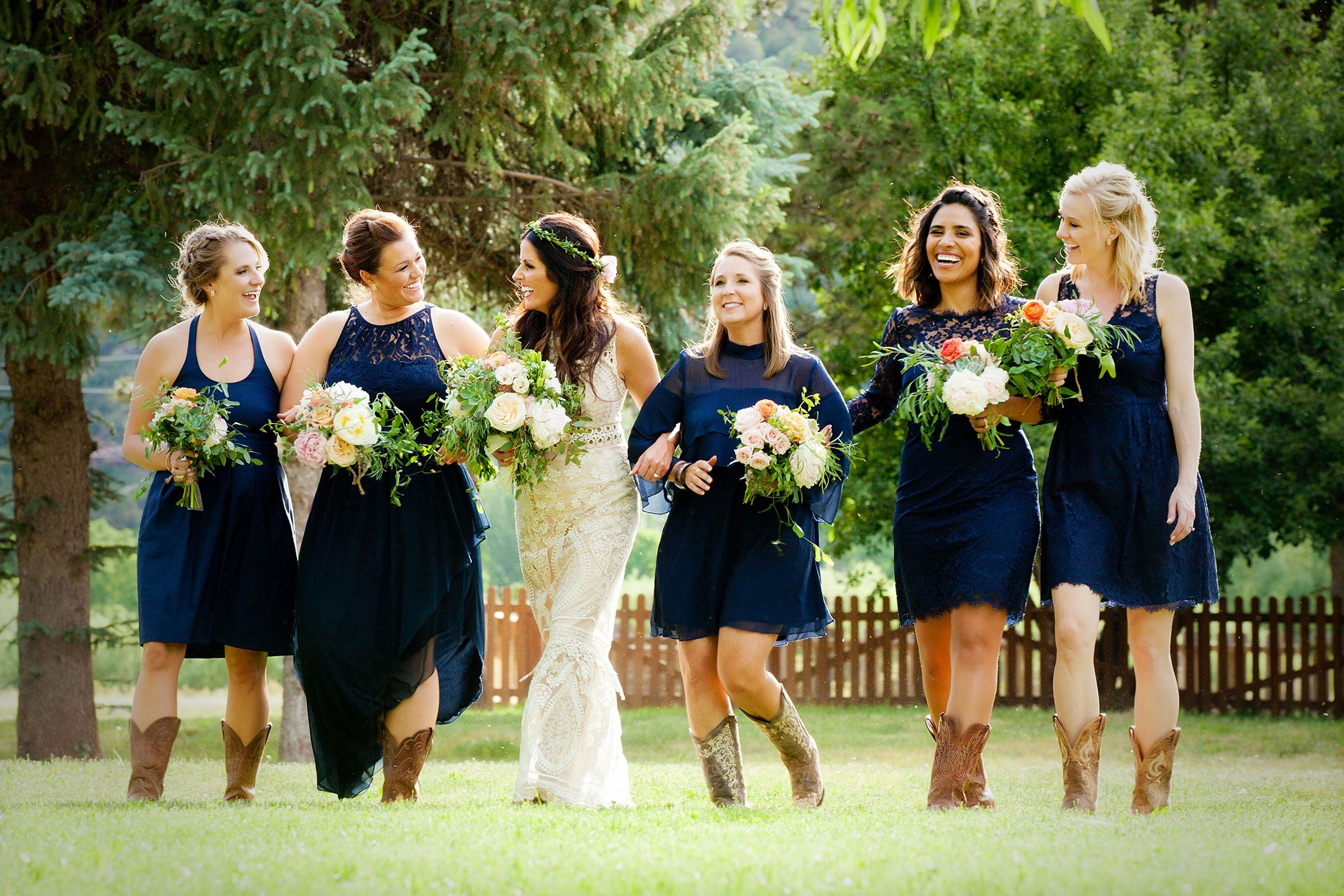 Birdesmaids wearing navy blue dresess and cowboy boots | Durango, Colorado