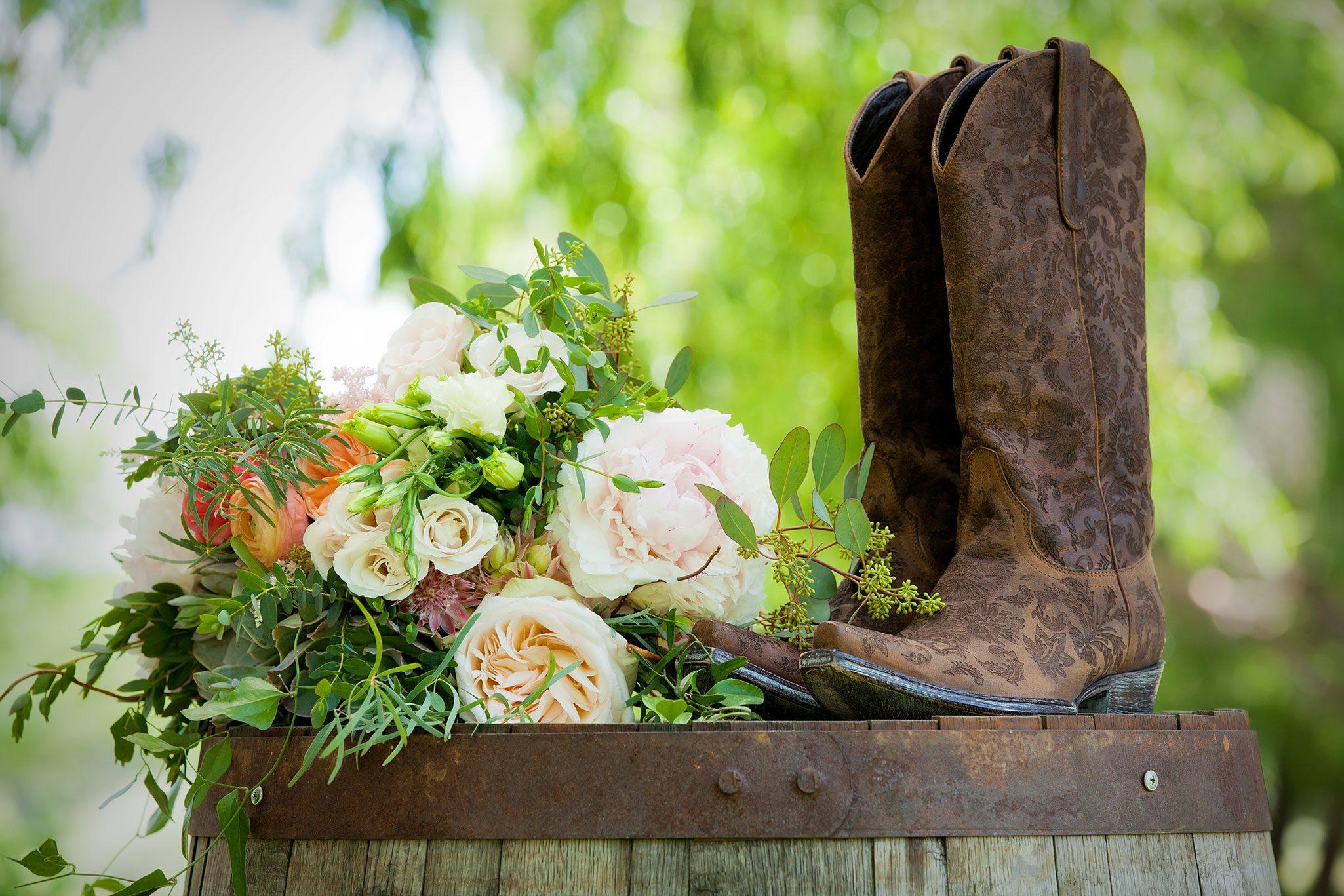 Wedding bouquet and cowboy boots on wine barrel | Durango, Colorado