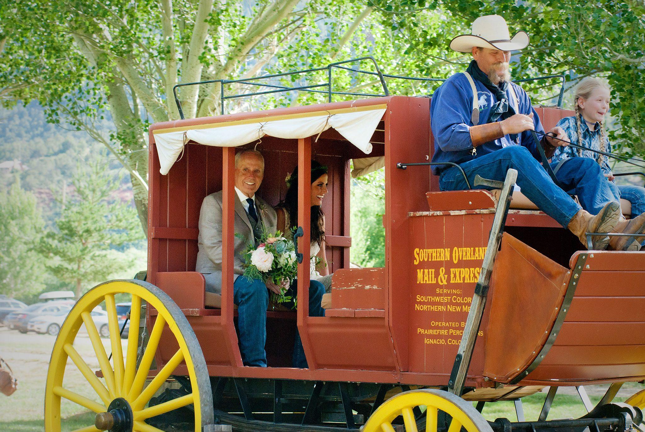 Bride and dad arriving to ceremony via old west stage coach - Durango, Colorado