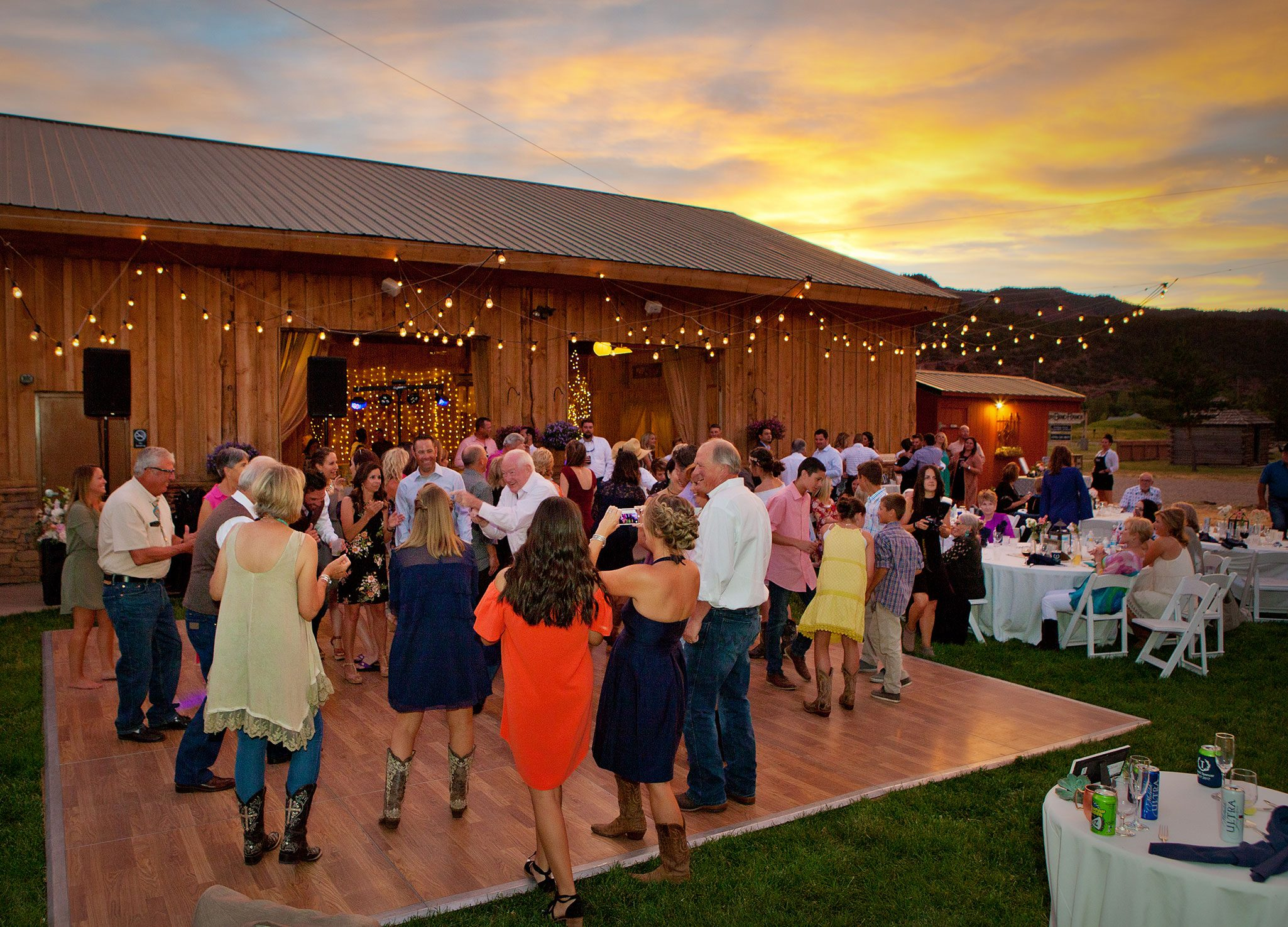 Outdoor wedding reception dancing | Durango, Colorado