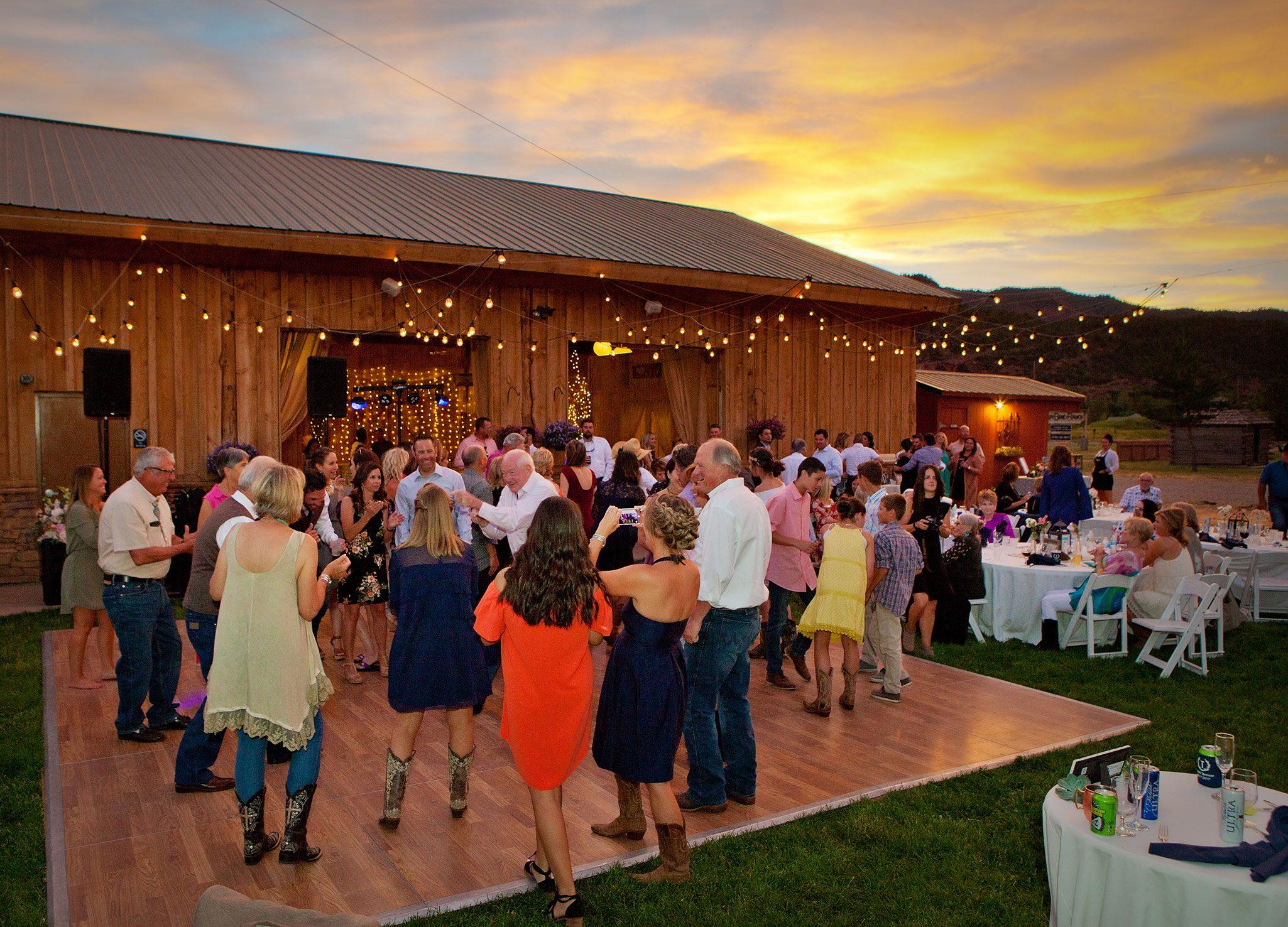 Outdoor wedding reception dancing | Durango, Colorado