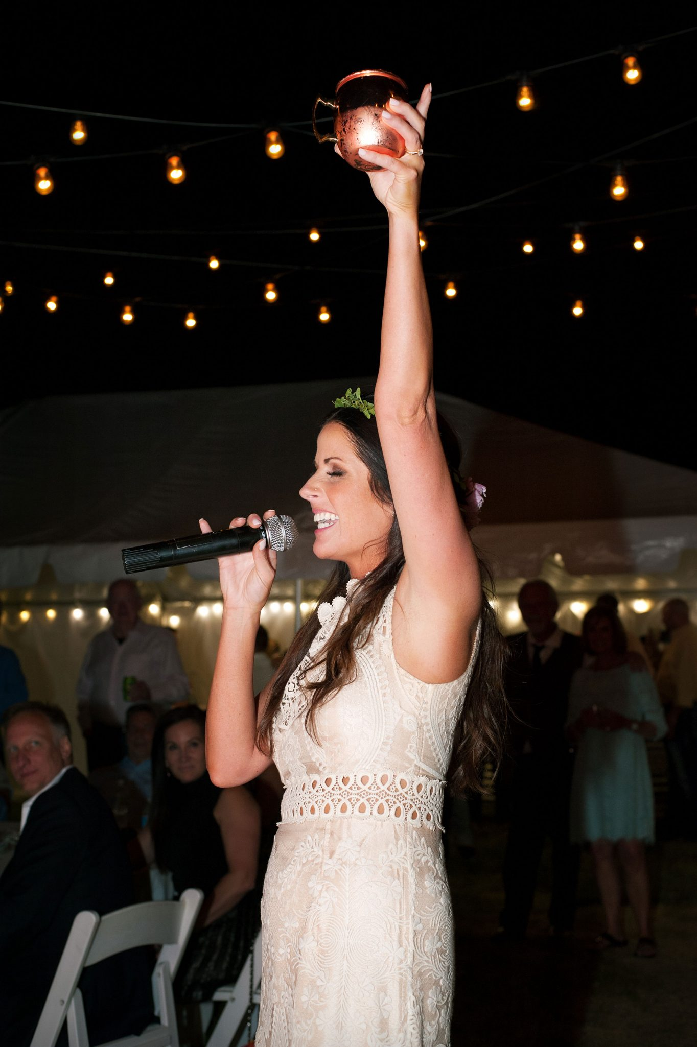 Happy, singing bride with microphone