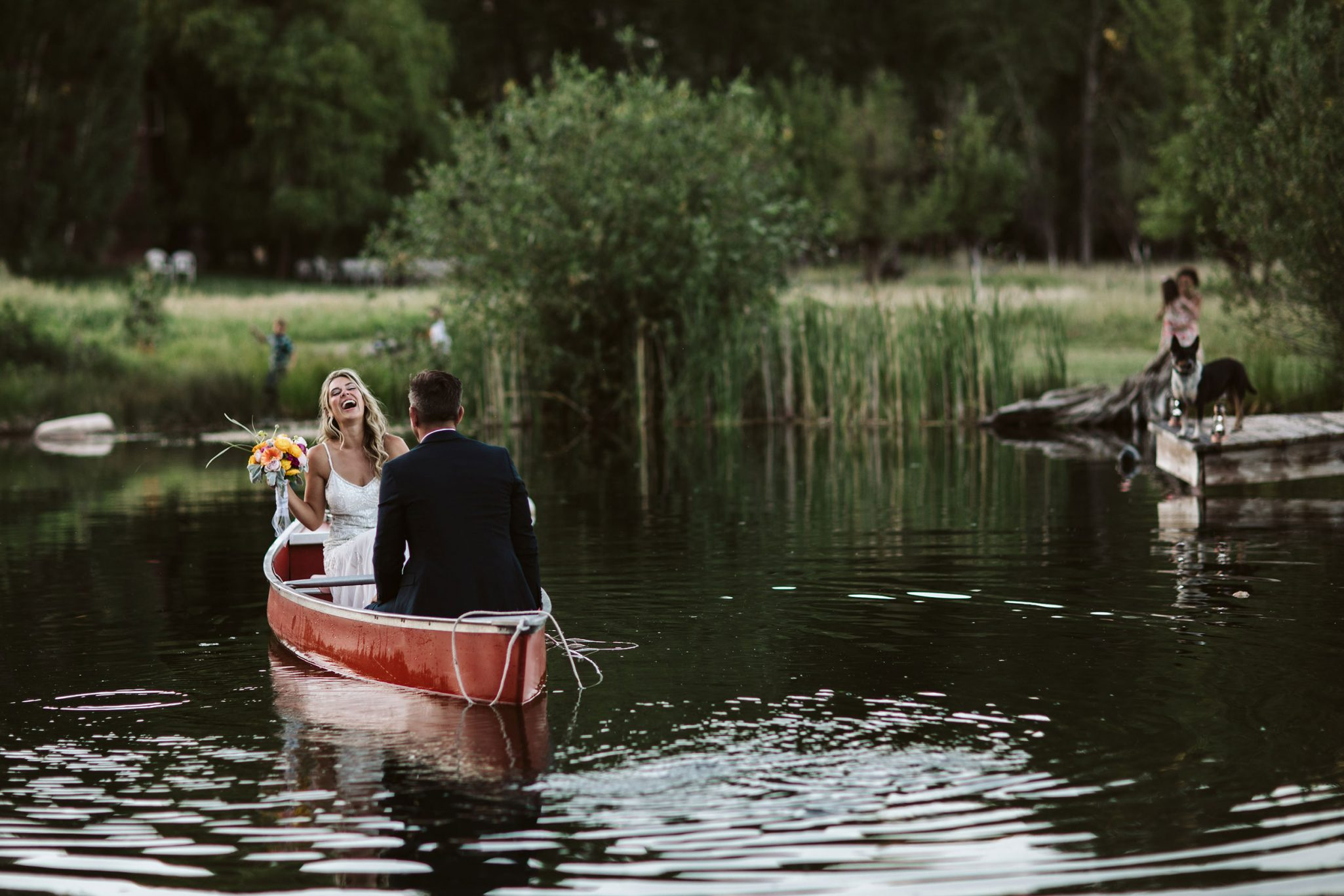 Bride & groom in a canoe
