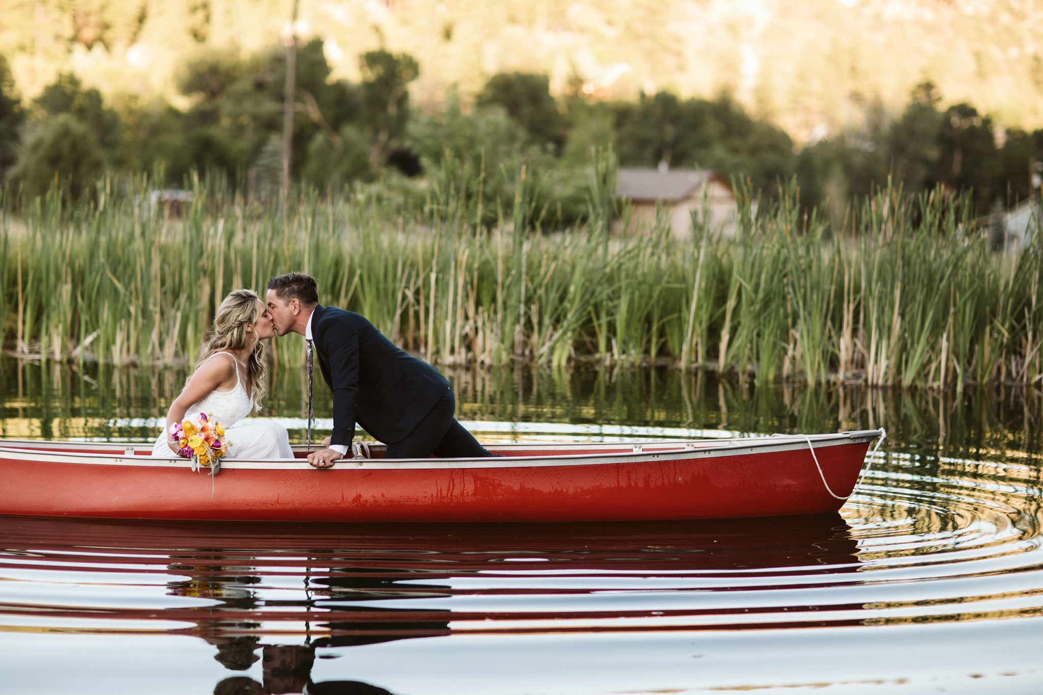 Bride & Groom in a red canoe, Durango Colorado