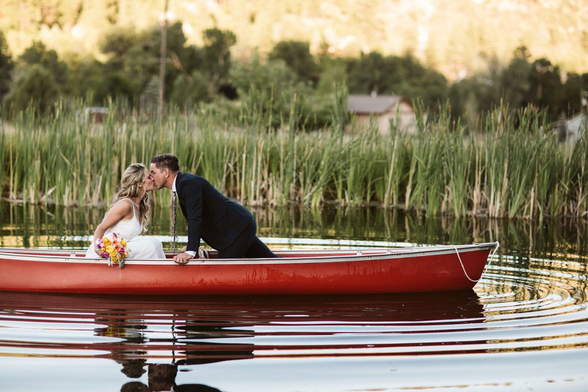 Bride & Groom in a red canoe, Durango Colorado