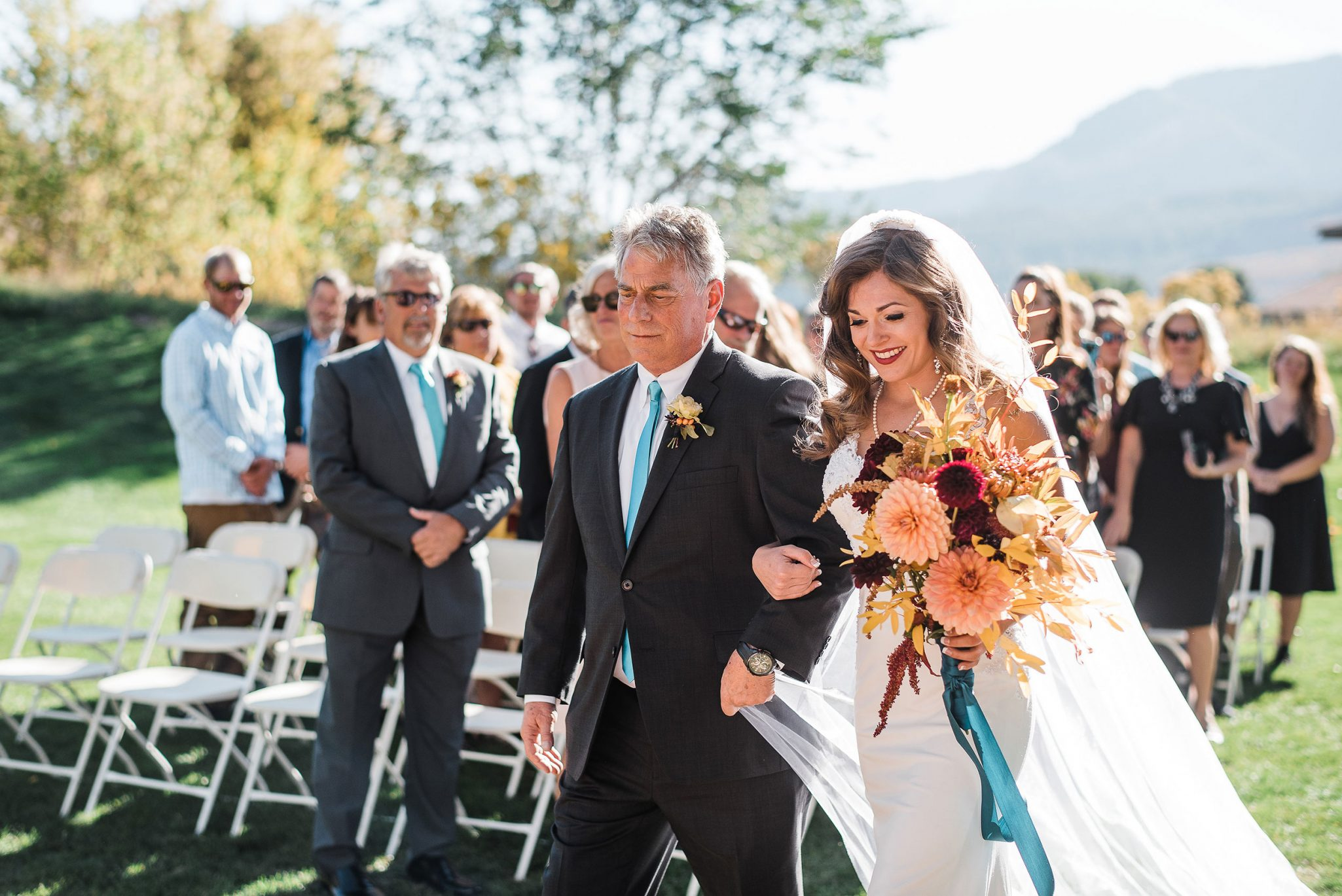Walking down the aisle with dad at Dalton Ranch Golf Club, Durango Colorado