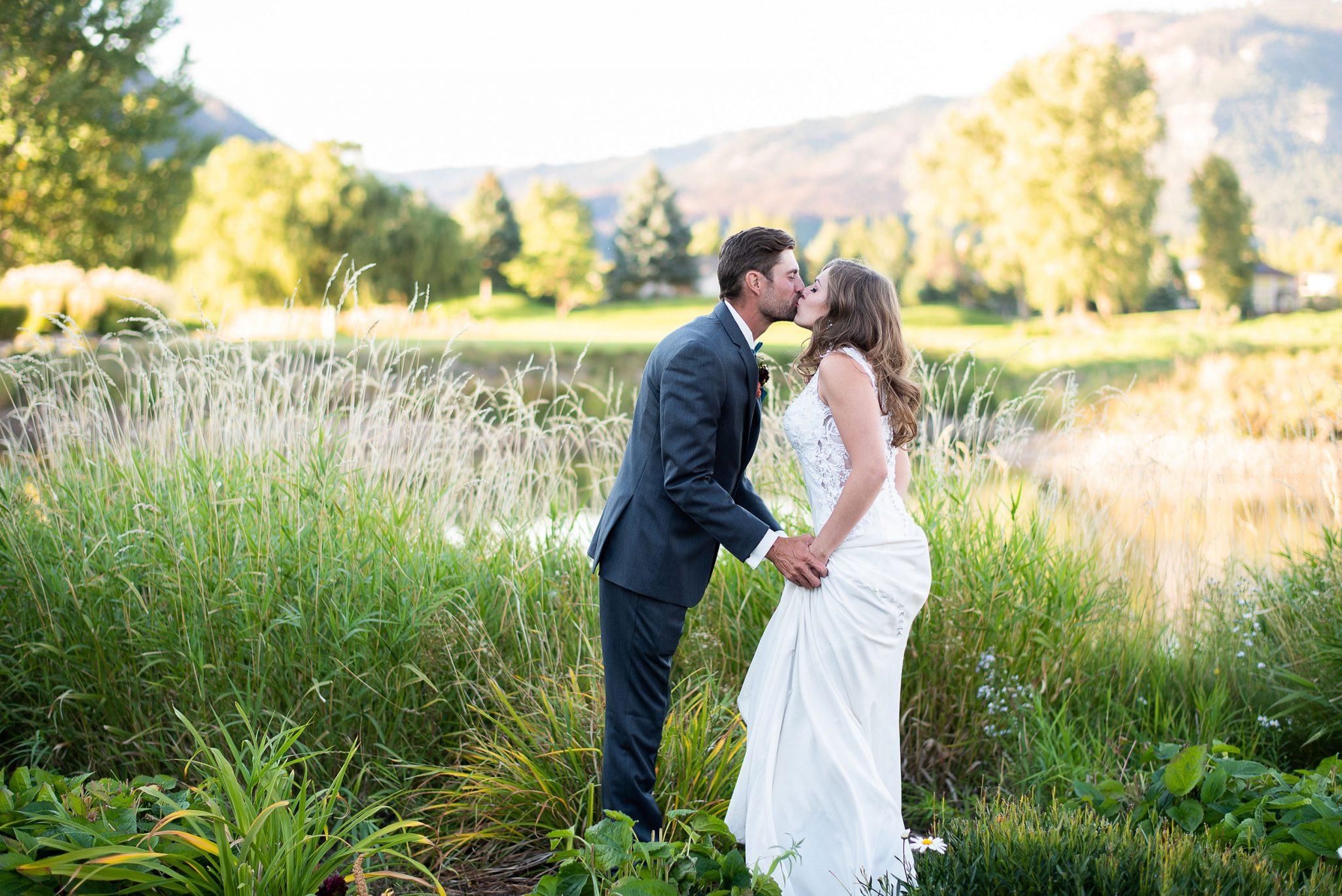 Bride & Groom kissing at Dalton Ranch Golf Club, Durango Colorado