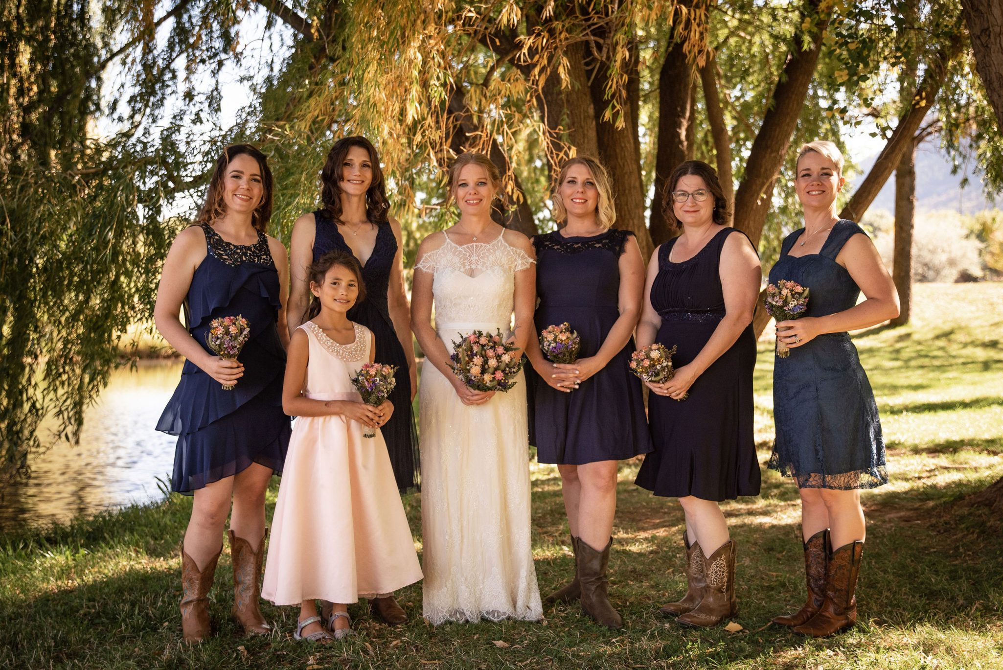 Bridesmaids with cowboy boots and blue dresses   Durango Weddings Magazine
