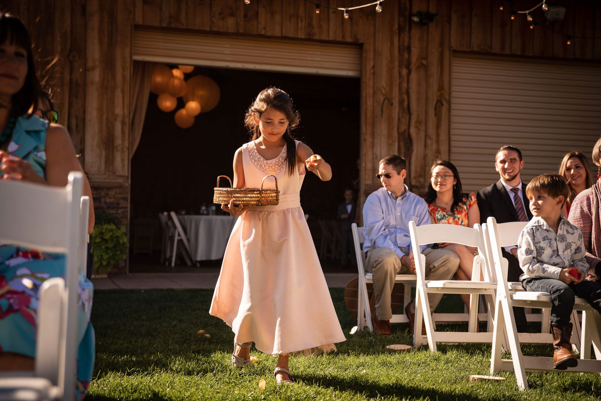 Flower girl walking down the aisle | Durango Weddings Magazine