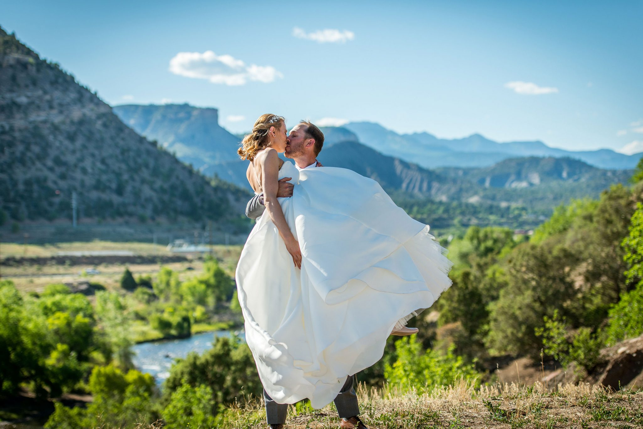 Bride & Groom along the Animas River via Durango Weddings Magazine
