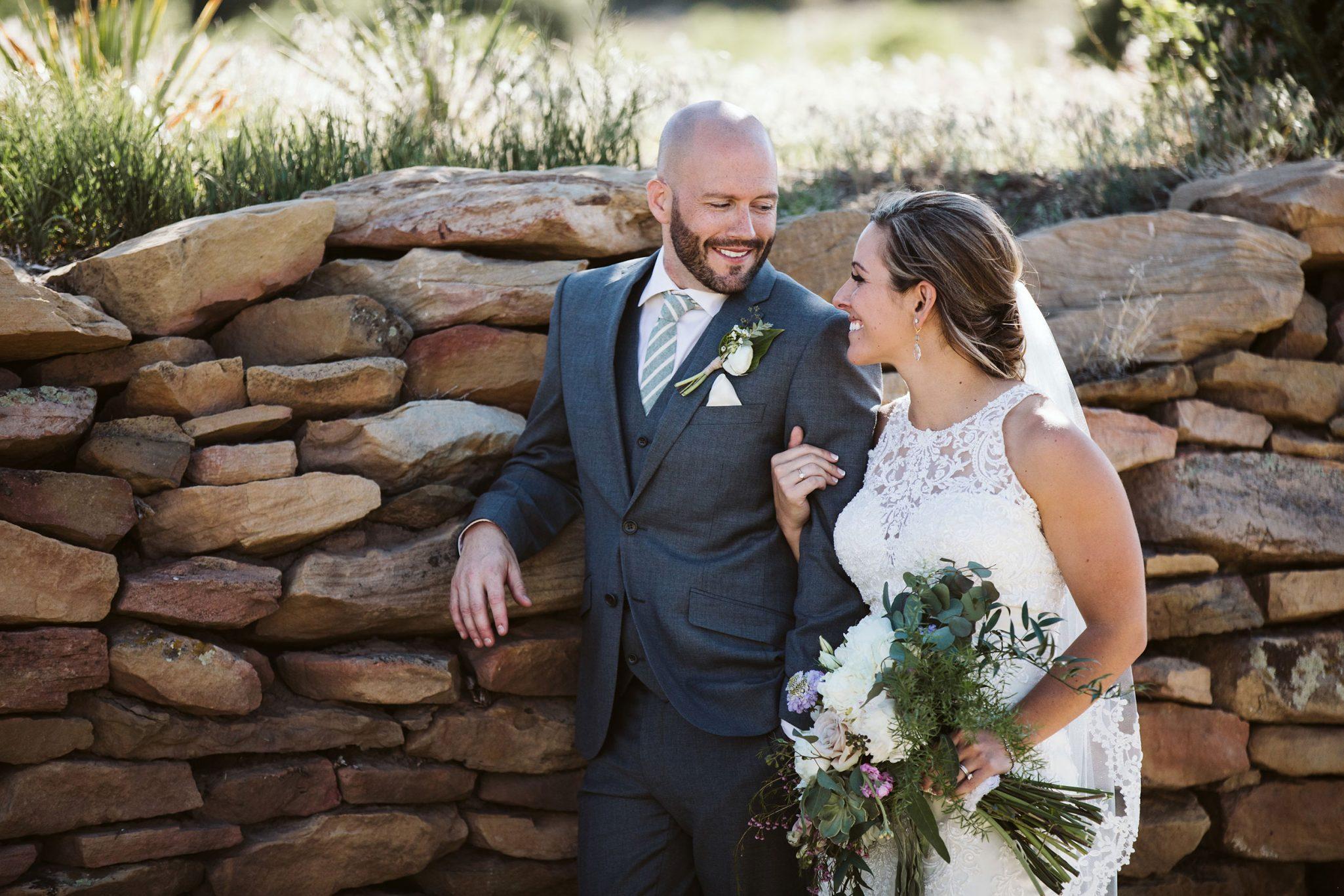 Happy bride & groom at Sophia Retreat Center | Durango Weddings Magazine
