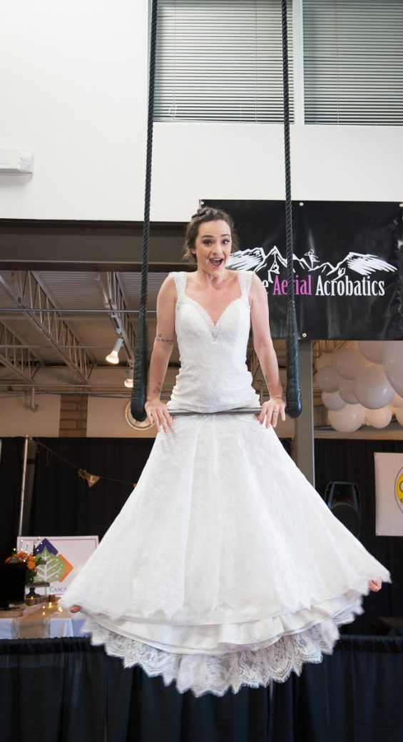 Bride on the trapeze at the Durango Wedding Expo