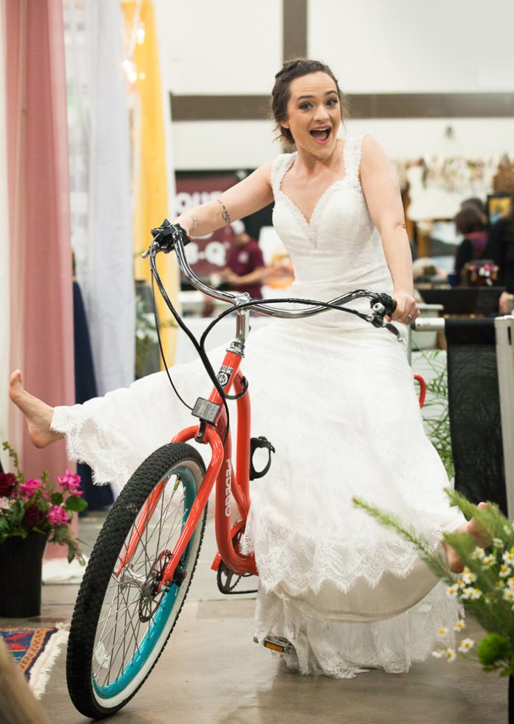 Bride on ebike at the Durango Wedding Expo