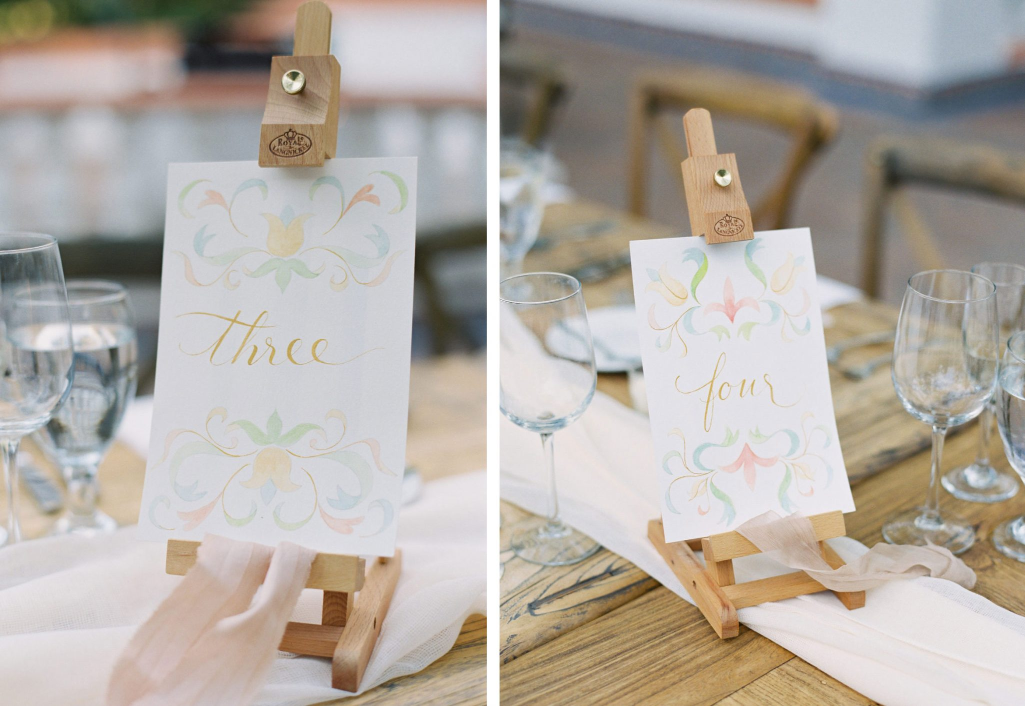 Tiny art easels hold handmade table numbers.