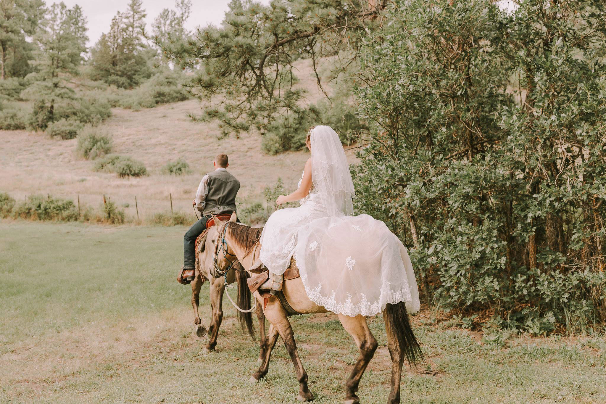 Bride & Groom on horseback after the ceremony at Paradise Ranch in Pagosa Springs, Colorado