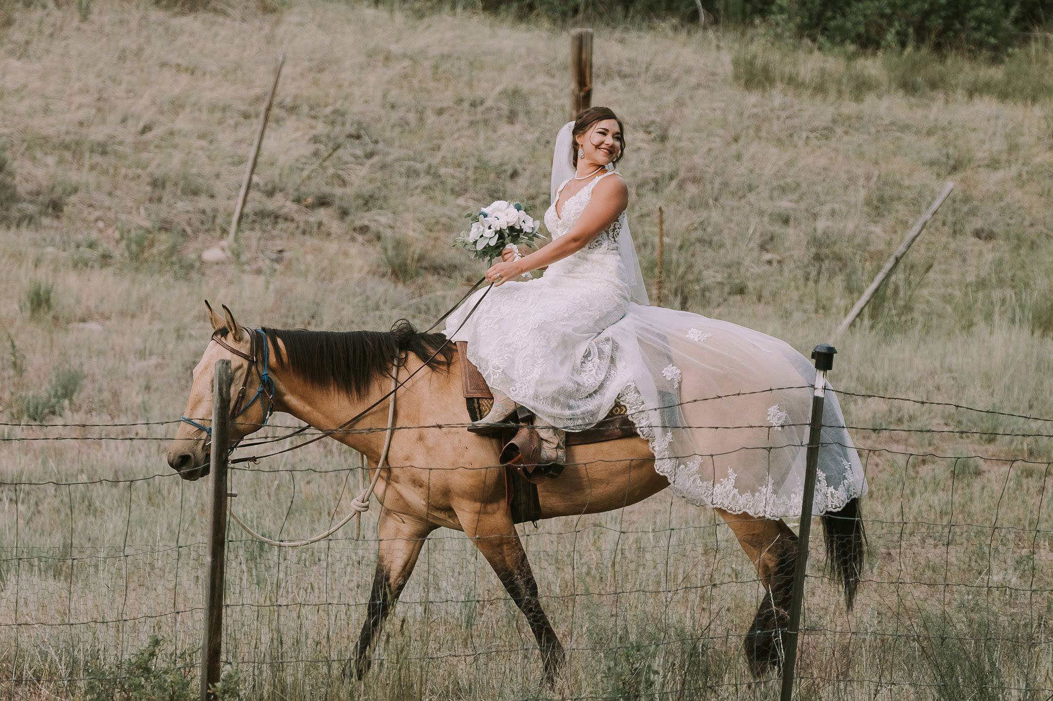 Bride on horseback at Paradise Ranch in Pagosa Springs, Colorado