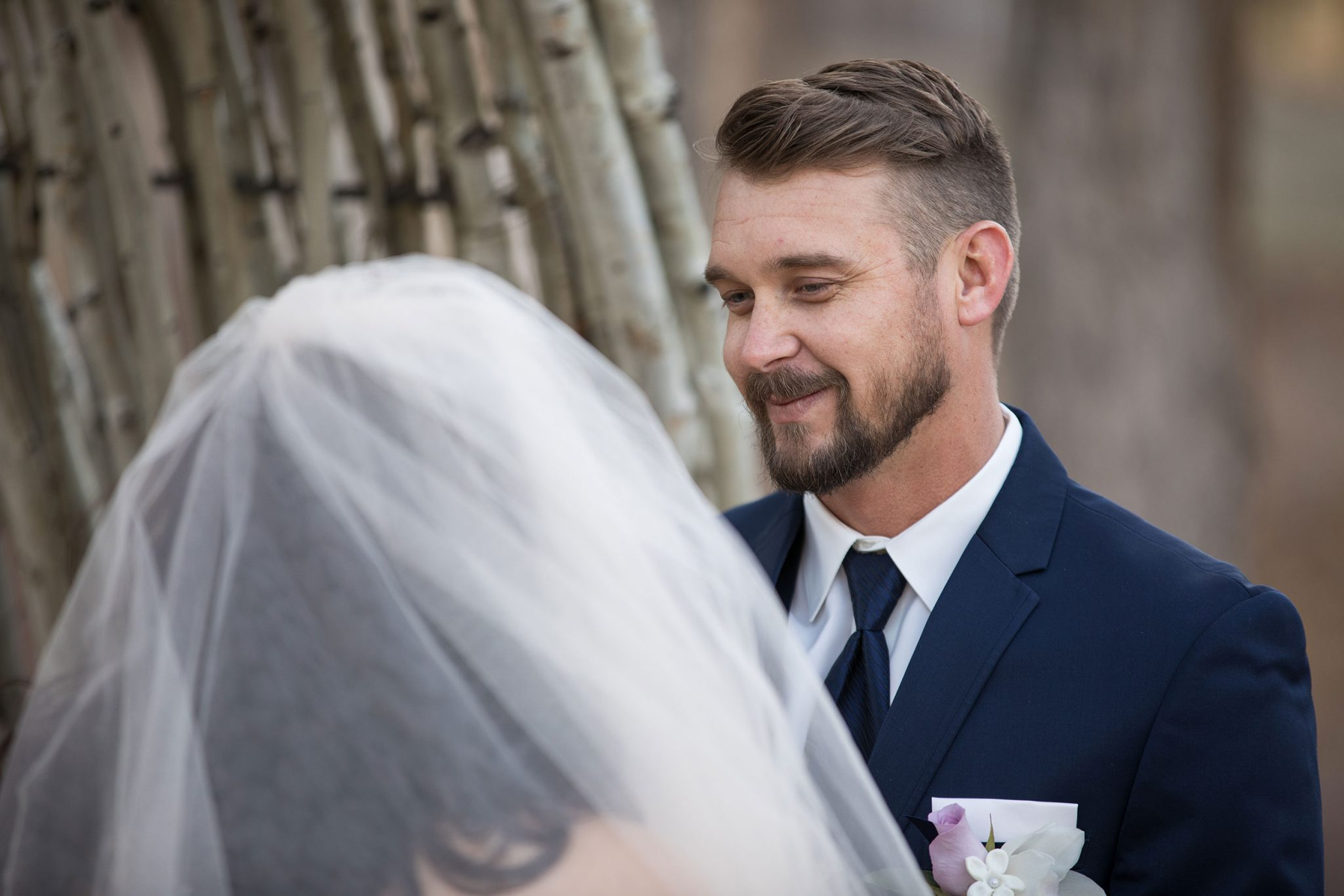 Happy groom during ceremony