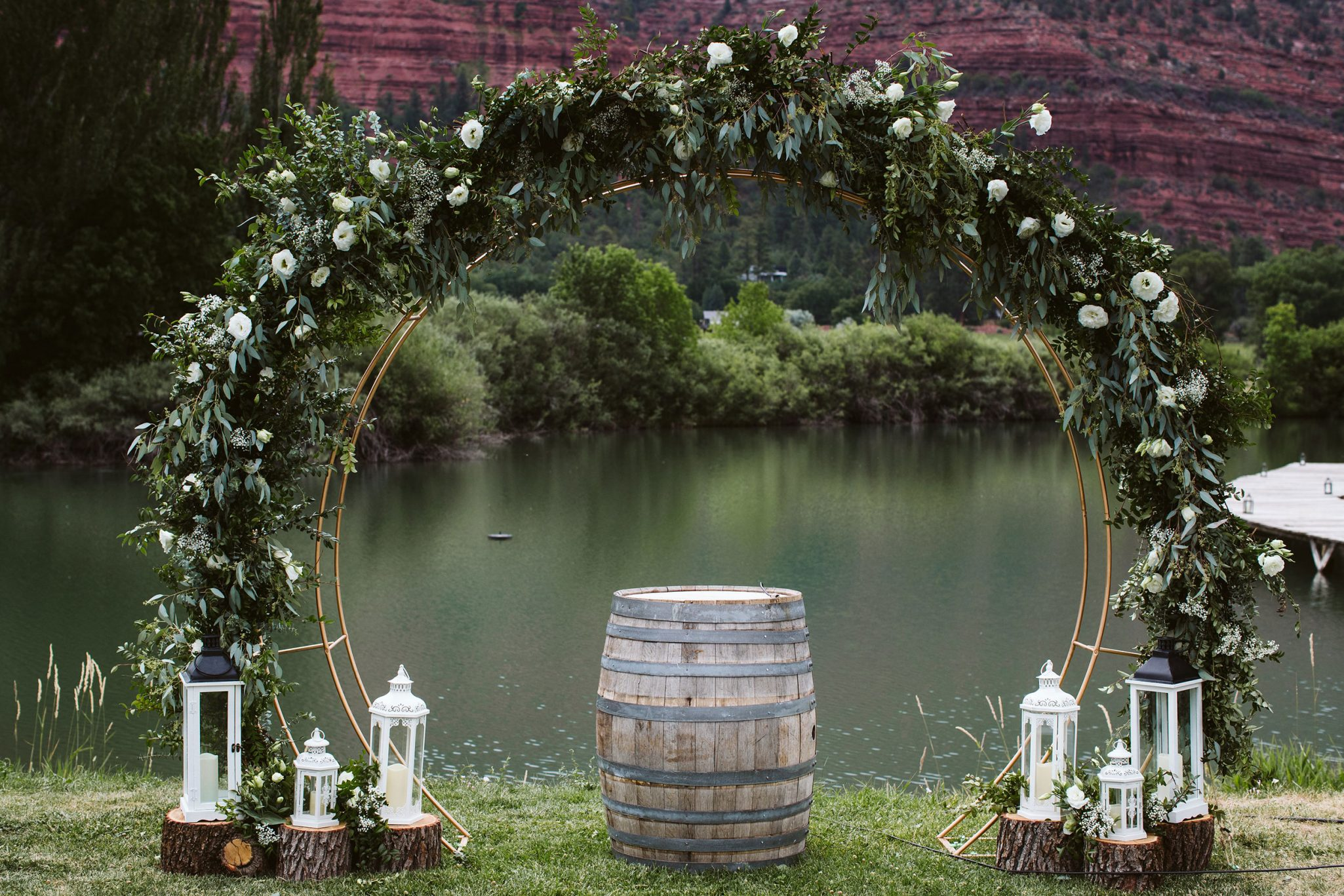 Ceremony hoop covered in greenery & white florals