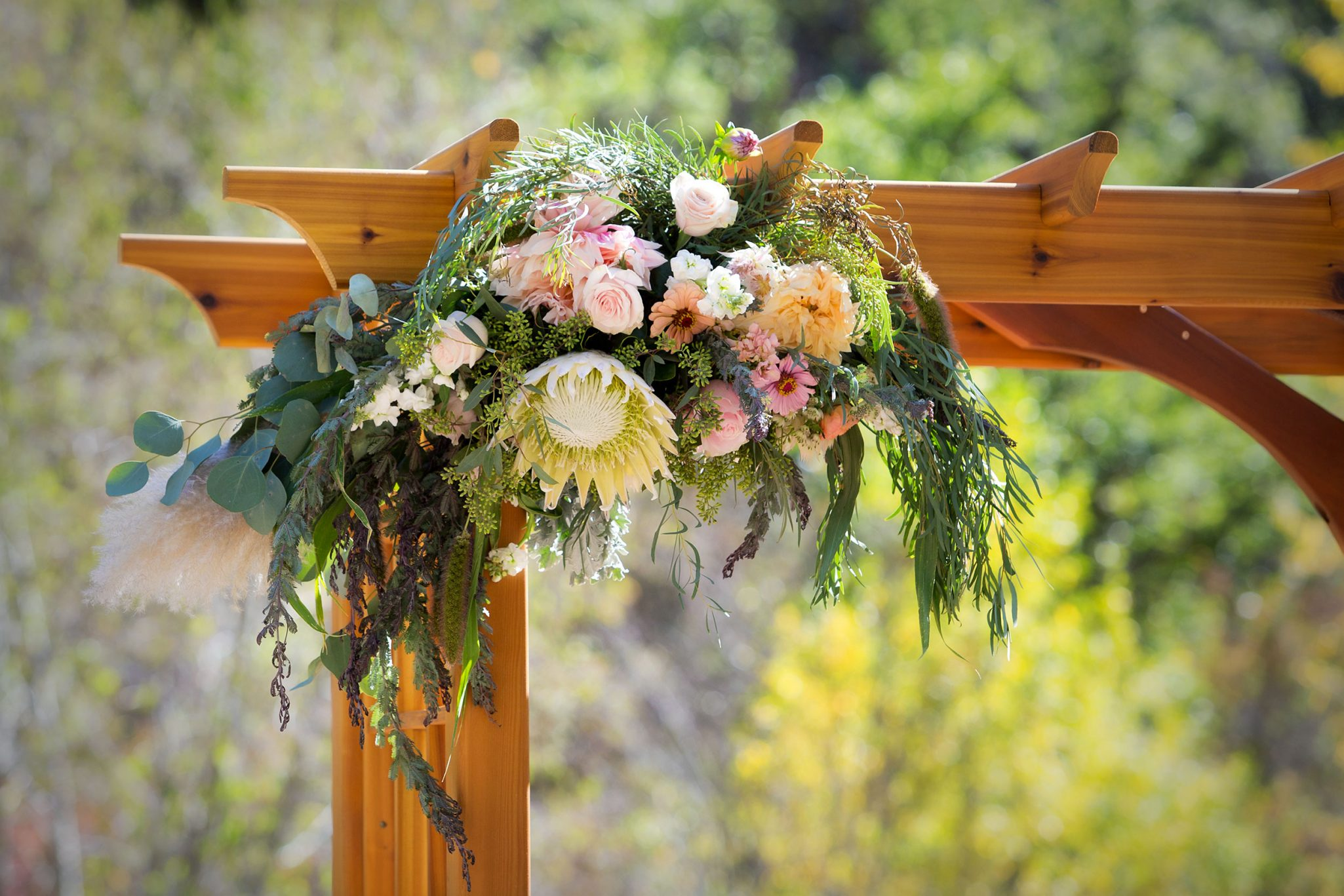 Ceremony arbor floral spray by Adela Floral