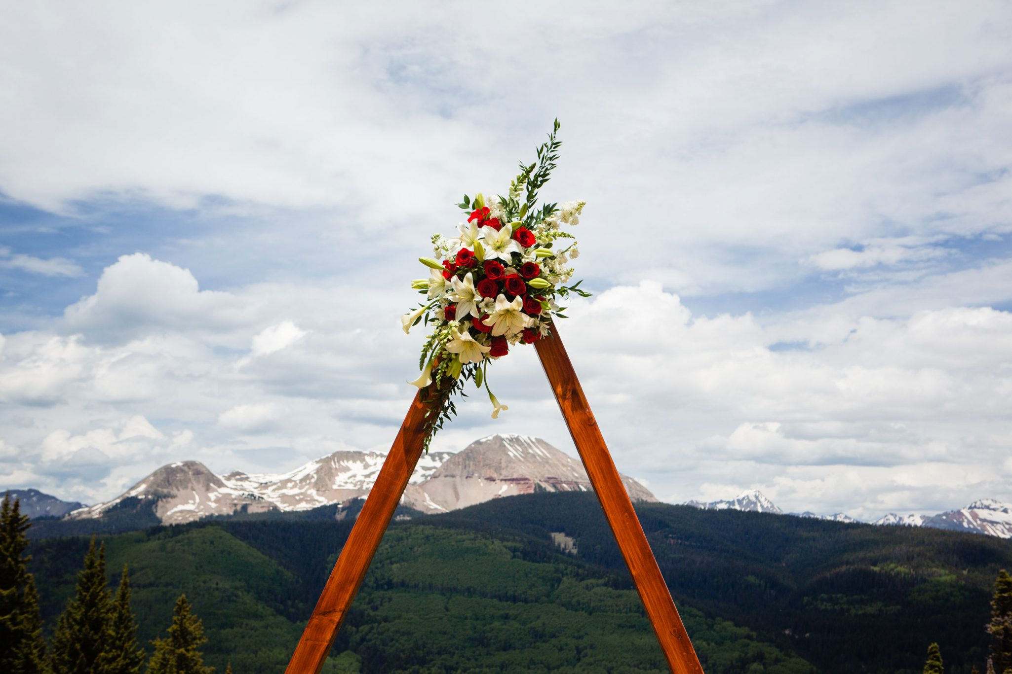 Ceremony arch shaped like a mountain | Durango Weddings Magazine