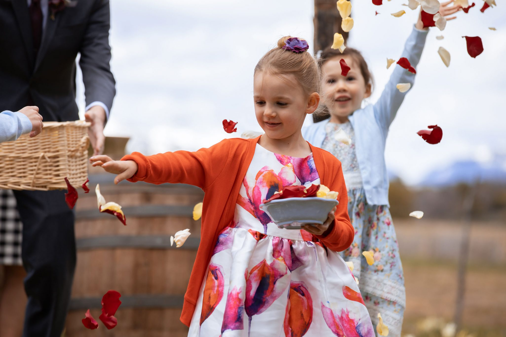 Flower girls throwing floral petals