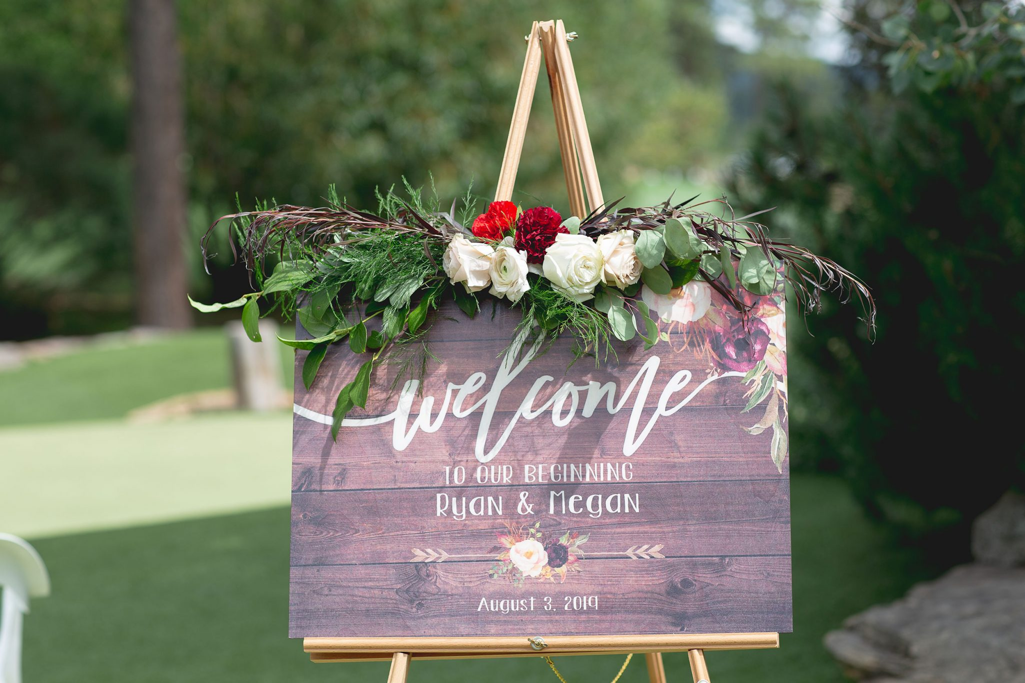 Welcome sign, flower swag by April's Garden Weddings
