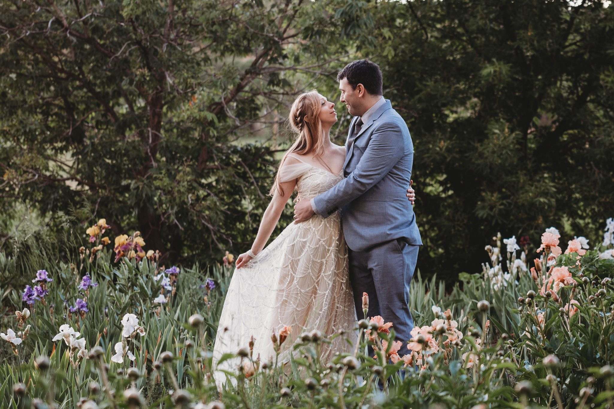 Bride & Groom in iris field at Ridgewood Event Center, Durango CO