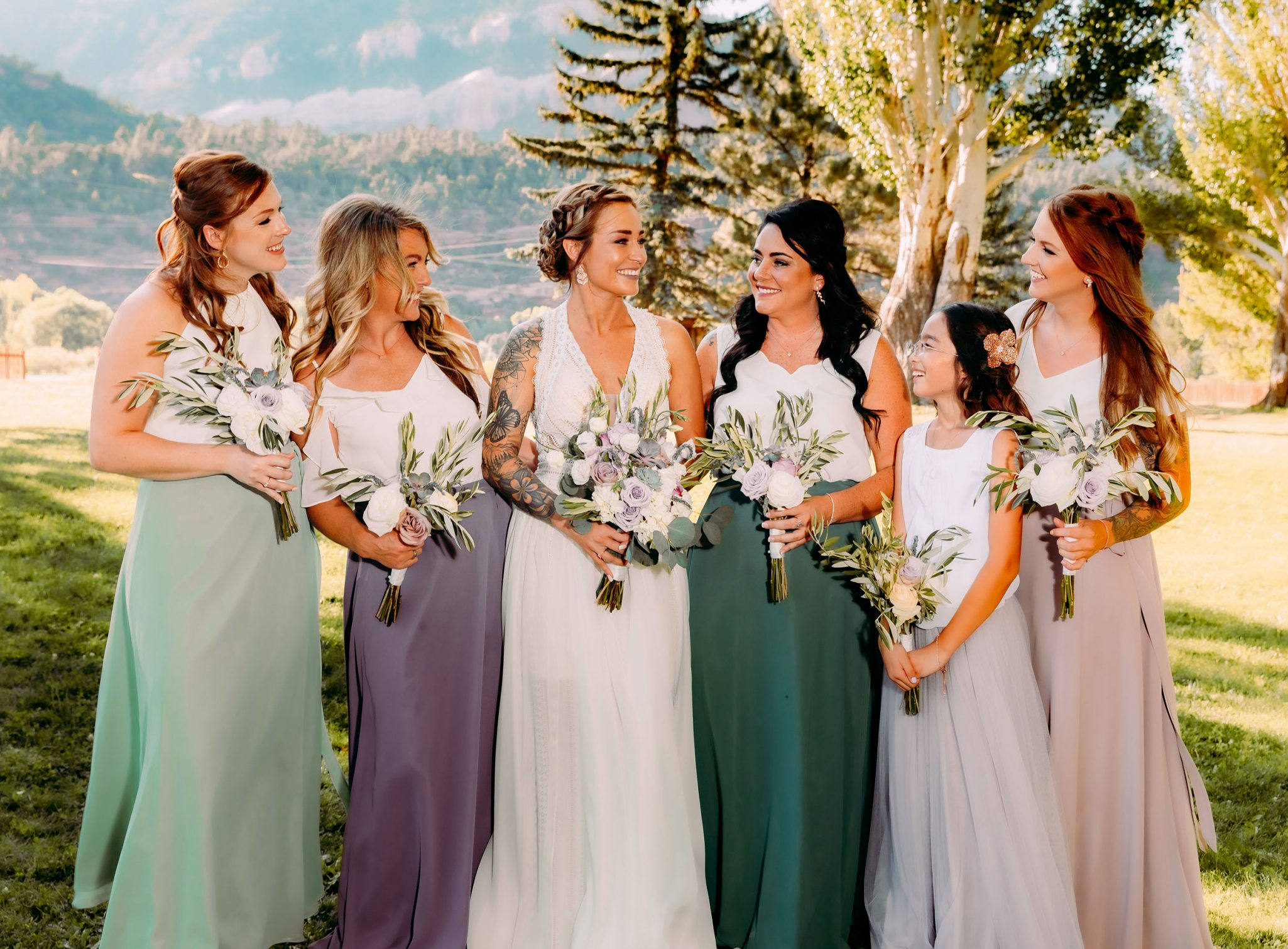 bridemaids in purple and pink