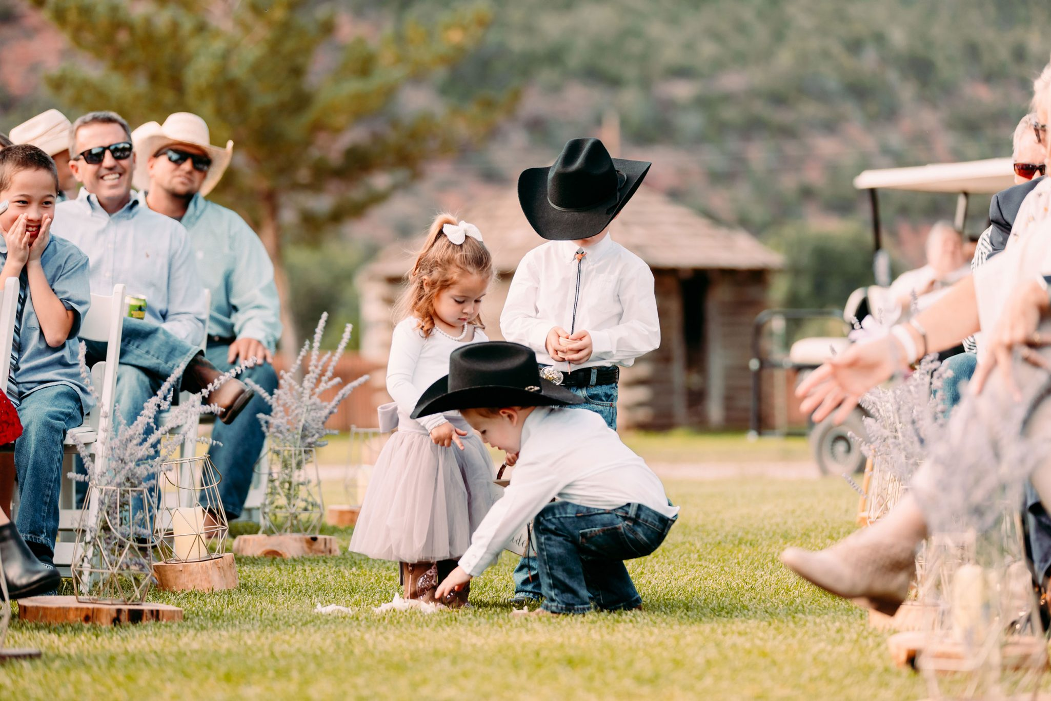 country flower girl and ring bearers in cowboy boots